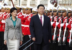 China's Vice President Xi, accompanied by Thailand's PM Yingluck, reviews an honour guard during a welcoming ceremony in Bangkok