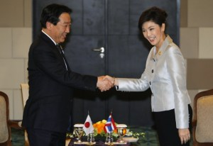 thailands-pm-yingluck-smiles-as-she-shakes-hands-with-her-japanese-cou1
